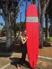 Me with my surf board. Not looking cute but definitely feeling accomplished​. Location: Santa Monica, California
